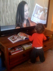 Child watching mom read book - FC photo